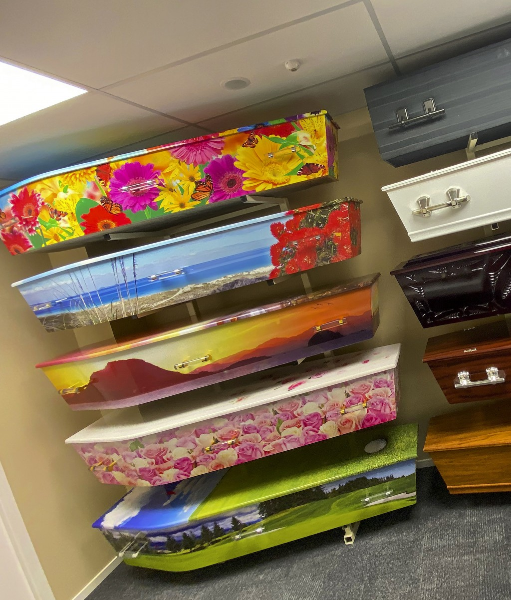 This photo provided by Ross Hall shows a selection of custom caskets in Auckland, New Zealand on May 20, 2020. Auckland company Dying Art makes unique...