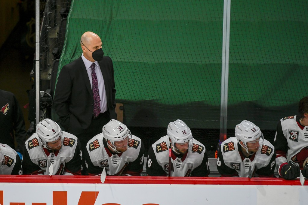 Arizona Coyotes head coach Rick Tocchet, standing, watches the game during the second period of an NHL hockey game Wednesday, April 14, 2021, in St. P...