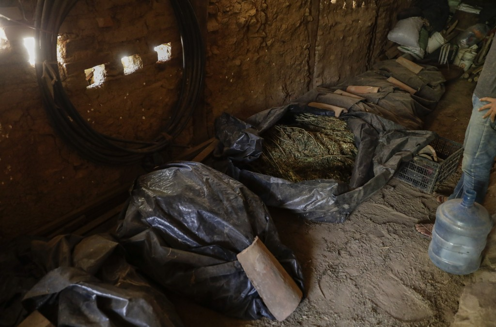 Bags of marijuana wait to be cleaned in a warehouse in the mountains surrounding Badiraguato, Sinaloa state, Mexico, Tuesday, April 6, 2021. Decades a...
