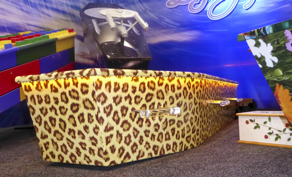 This photo provided by Ross Hall, shows a leopard skinned designed casket in Auckland, New Zealand on March 17, 2016. Auckland company Dying Art makes...
