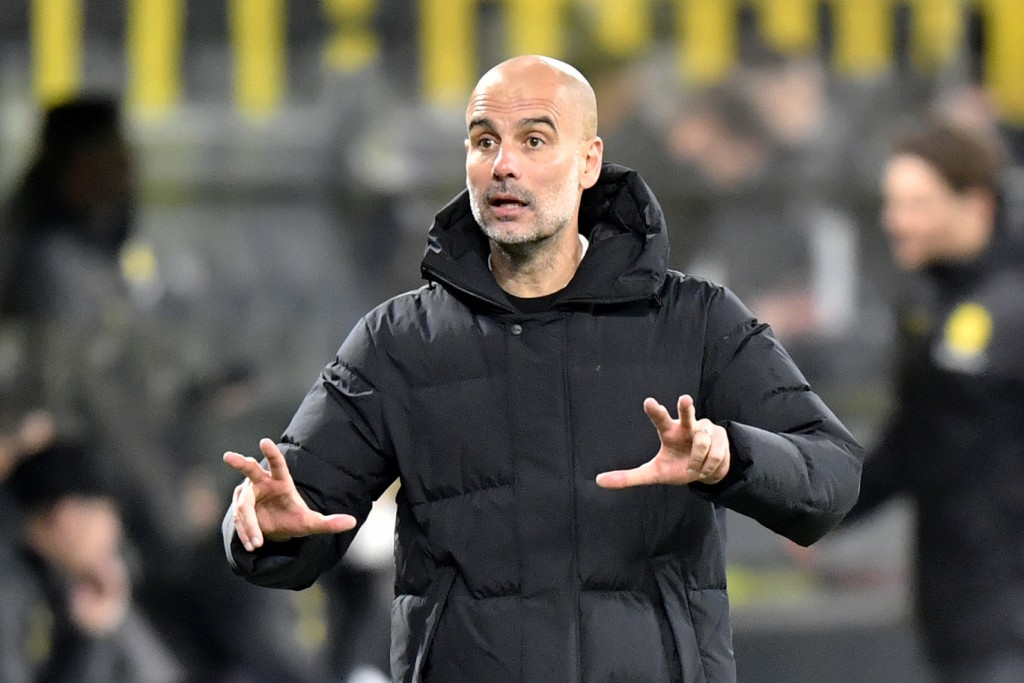Manchester City's head coach Pep Guardiola gestures during the Champions League quarterfinal second leg soccer match between Borussia Dortmund and Man...