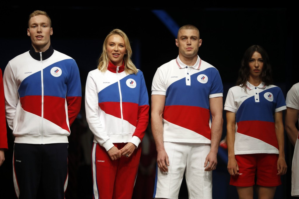 Athletes display the Olympic uniforms for Russian athletes in Moscow, Russia, Wednesday, April 14, 2021. Russia presents its Olympic kit for the Tokyo...
