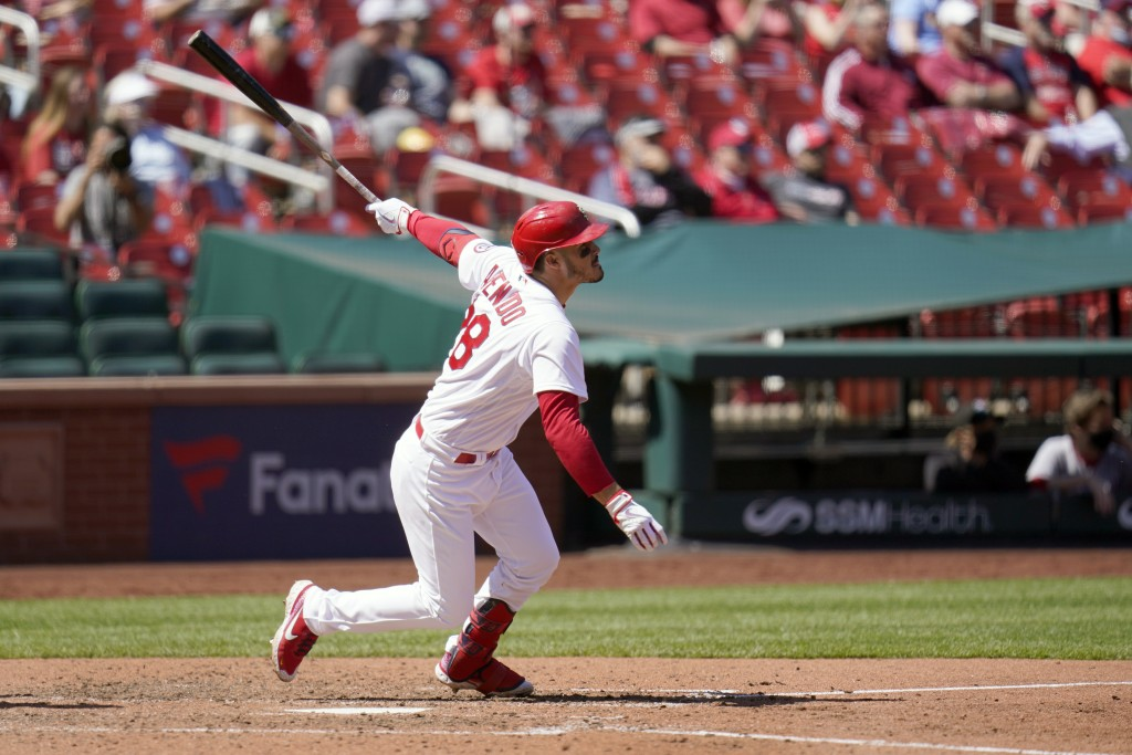 St. Louis Cardinals' Nolan Arenado doubles during the sixth inning of a baseball game against the Washington Nationals Wednesday, April 14, 2021, in S...