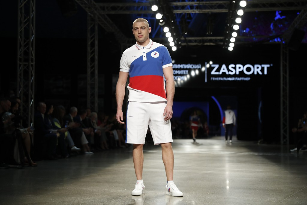 A model displays the Olympic uniforms for Russian athletes in Moscow, Russia, Wednesday, April 14, 2021. Russia presents its Olympic kit for the Tokyo...