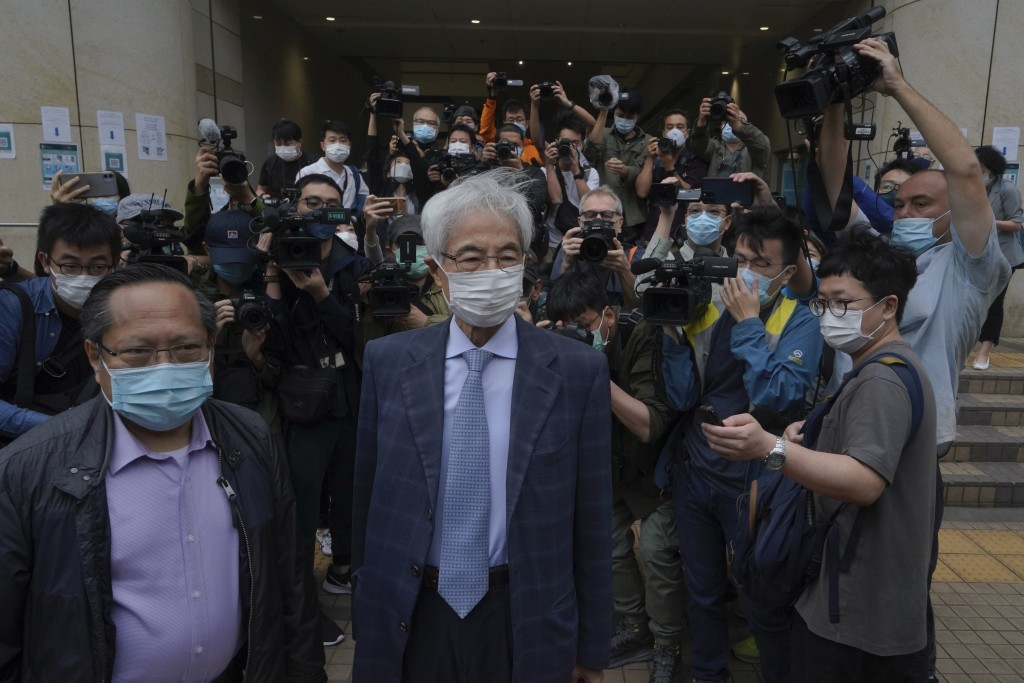 Pro-democracy activists Martin Lee, center, and Albert Ho, left, arrive at a court in Hong Kong Friday, April 16, 2021. Seven of Hong Kong's leading p...