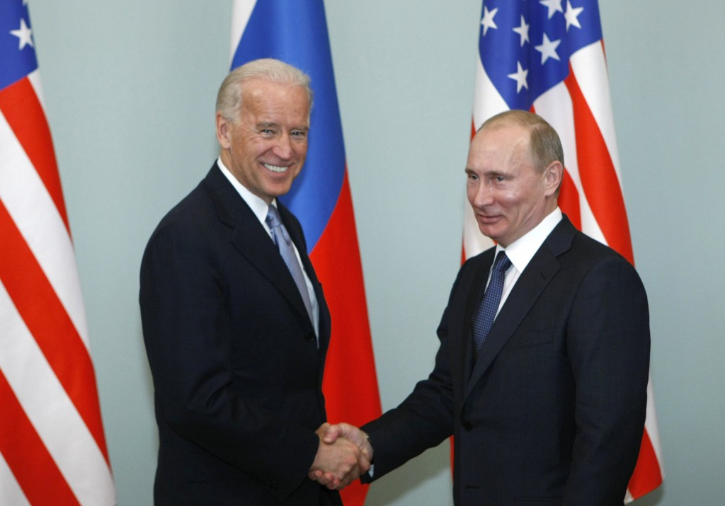 FILE - In this March 10, 2011, file photo, then-Vice President Joe Biden, left, shakes hands with Russian Prime Minister Vladimir Putin in Moscow, Rus...