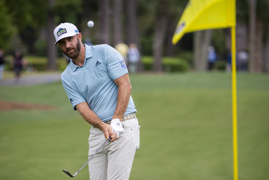 Dustin Johnson hits to the ninth green during the first round of the RBC Heritage golf tournament in Hilton Head Island, S.C., Thursday, April 15, 202...