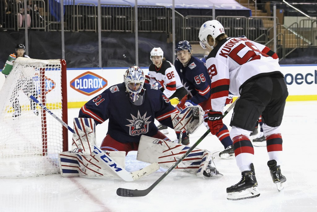 New York Rangers goalie Igor Shesterkin (31) blocks the net against New Jersey Devils' Janne Kuokkanen (59) during the first period of an NHL hockey g...