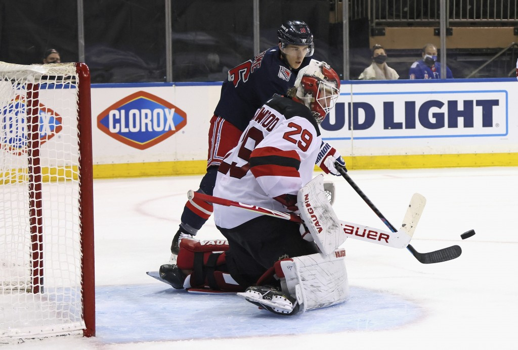 New York Rangers' Ryan Strome (16) attempts to deflect a second-period shot past New Jersey Devils goalie Mackenzie Blackwood (29) during an NHL hocke...
