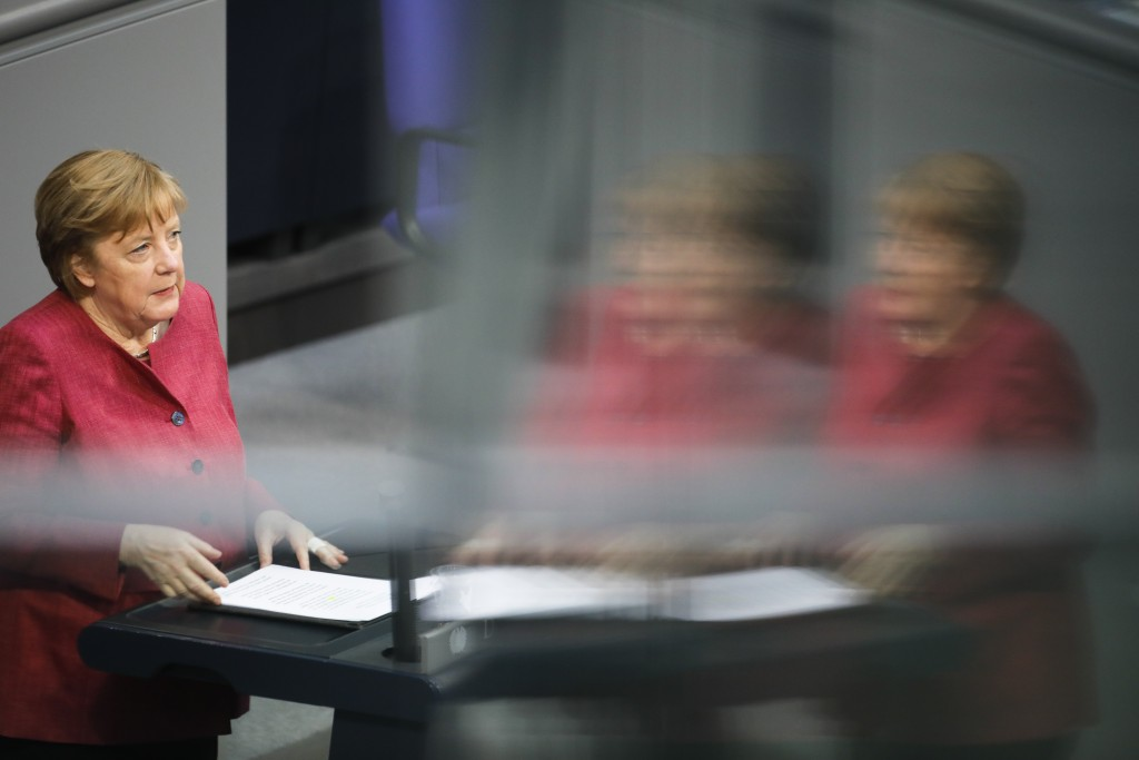 German Chancellor Angela Merkel delivers her speech during a parliament session about a new law to battle the coronavirus pandemic at the parliament B...