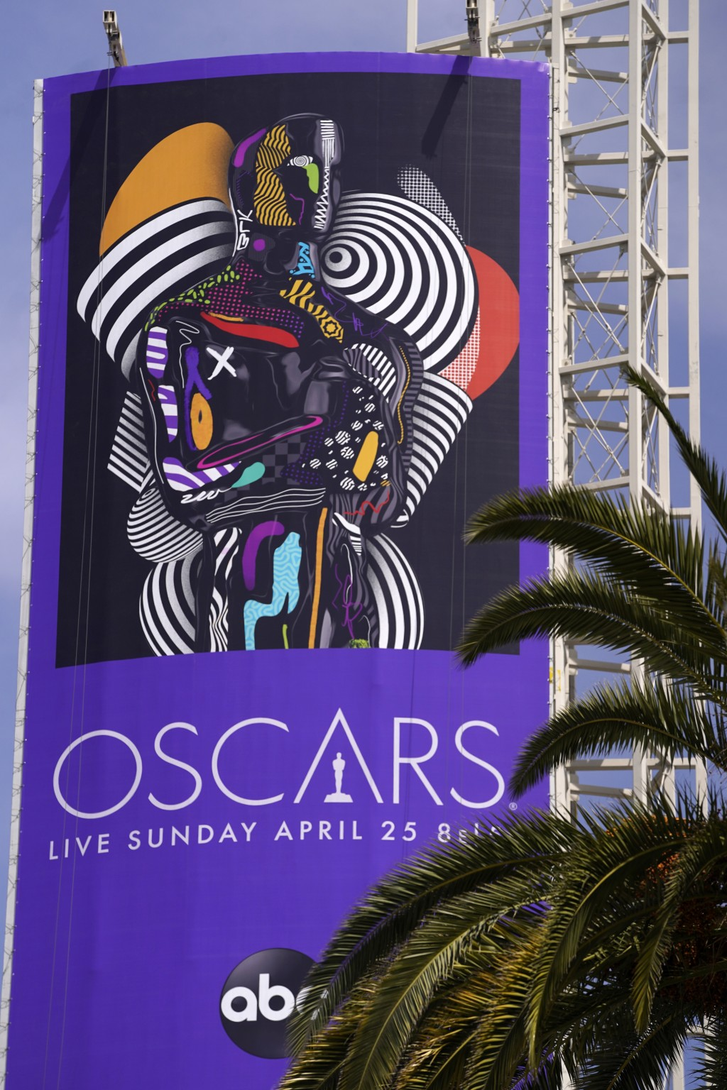 A sign advertising this year's Oscars ceremony is pictured near the Dolby Theatre, Thursday, April 15, 2021, in Los Angeles. The Dolby Theatre is one ...