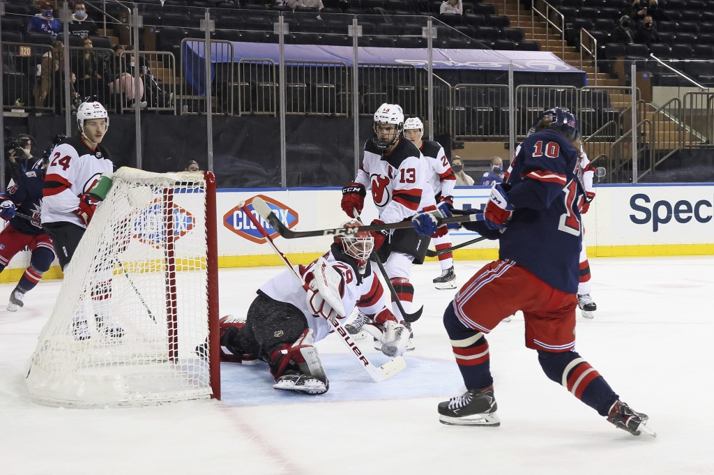 New York Rangers' Artemi Panarin (10) scores in the second period against New Jersey Devils' Mackenzie Blackwood (29) during an NHL hockey game Thursd...