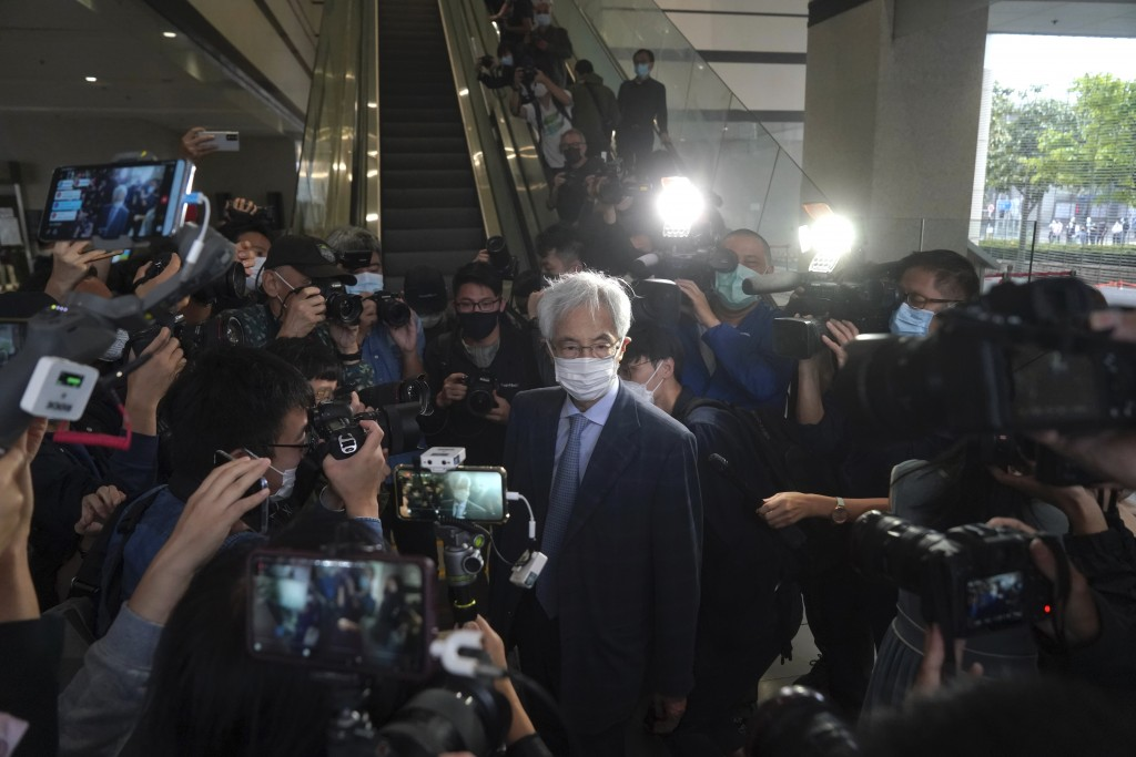 Pro-democracy activist Martin Lee, center, arrives at a court in Hong Kong Friday, April 16, 2021. Seven of Hong Kong's leading pro-democracy advocate...