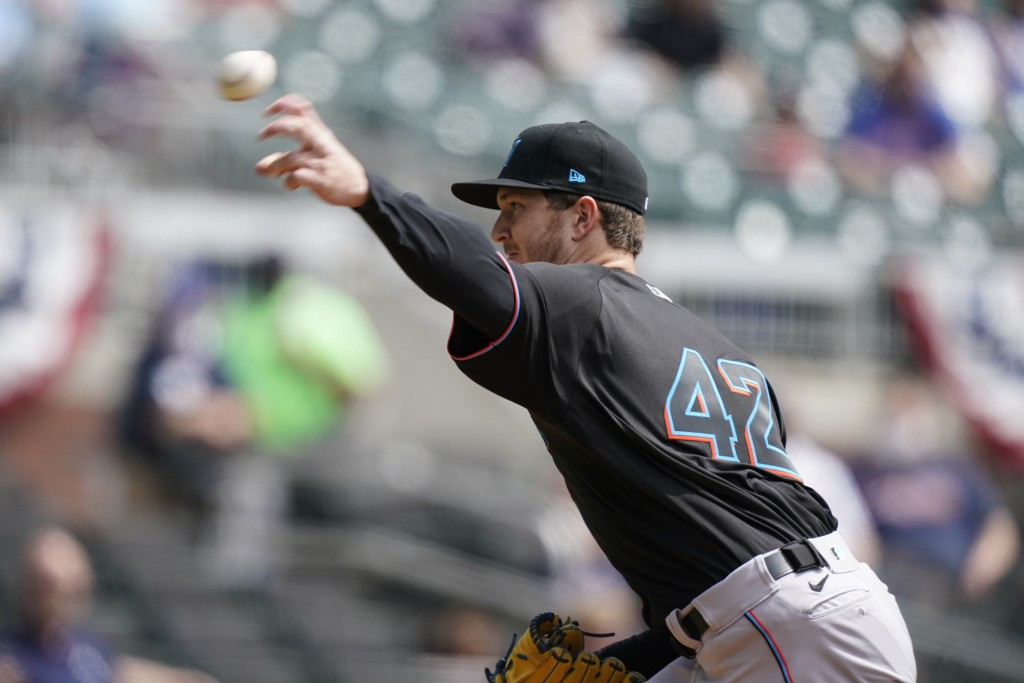 Miami Marlins starting pitcher Trevor Rogers (28) delivers in the first inning of a baseball game against the Atlanta Braves on Thursday, April 15, 20...