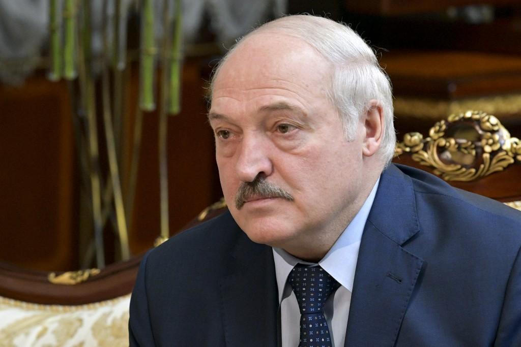 Belarusian President Alexander Lukashenko listens to Russian Prime Minister Mikhail Mishustin during their talks in Minsk, Belarus, Friday, April 16, ...