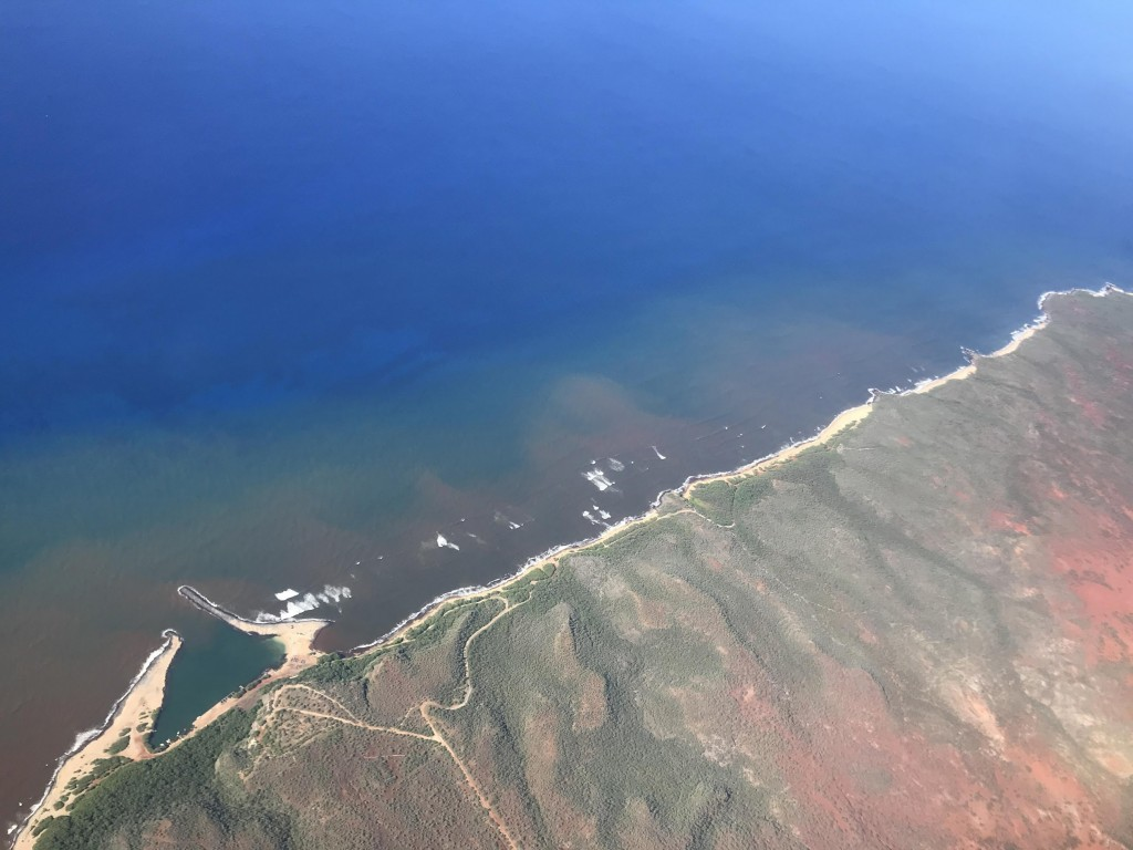 In this 2020 aerial photo provided by the Arizona State University's Global Airborne Observatory, runoff from the island of Molokai in Hawaii flows in...
