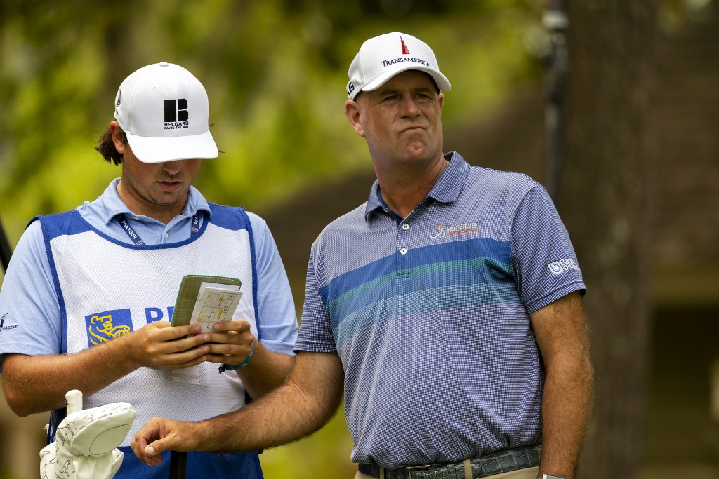 Stewart Cink looks down the eighth fairway before he tees off during the first round of the RBC Heritage golf tournament in Hilton Head Island, S.C., ...