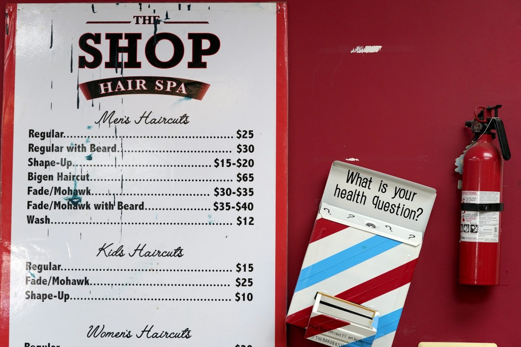 A box encouraging barber shop patrons to submit health questions is displayed at The Shop, Friday, April 9, 2021, in Hyattsville, Md. Barbers are memb...