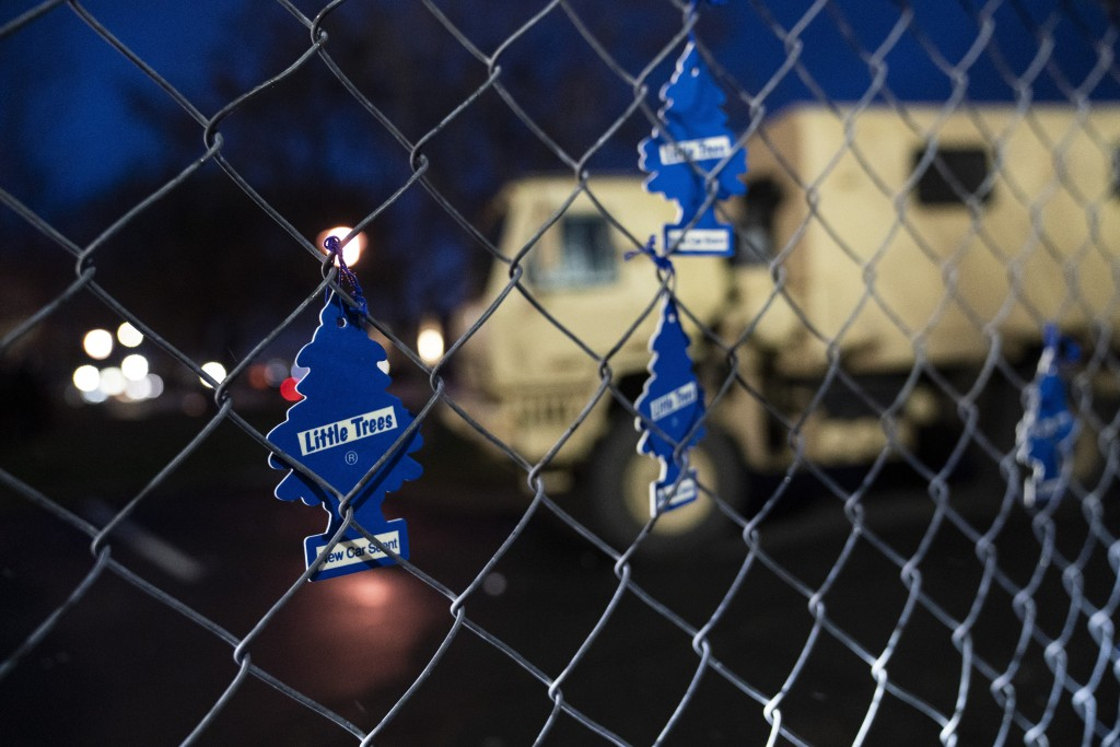FILE - In this April 13, 2021, file photo, demonstrators hang car air fresheners from a perimeter fence outside the Brooklyn Center Police Department ...