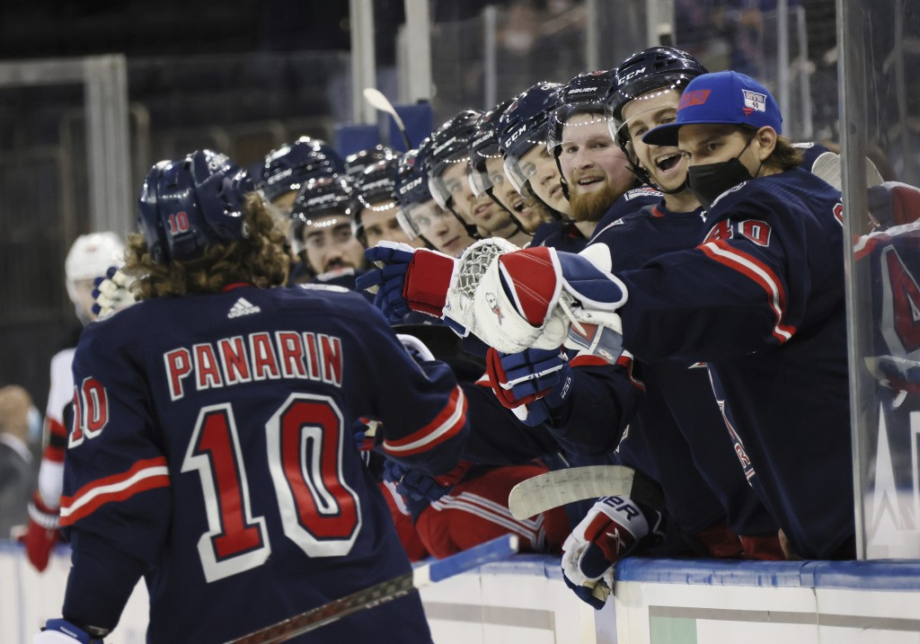 New York Rangers' Artemi Panarin (10) is congratulated for his second-period goal against the New Jersey Devils in an NHL hockey game Thursday, April ...