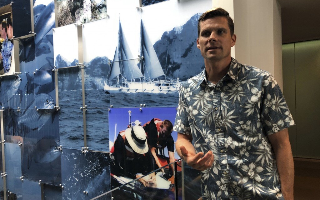 FILE - In this Sept. 16, 2019, file photo, National Oceanic and Atmospheric Administration research oceanographer Jamison Gove talks about coral at th...