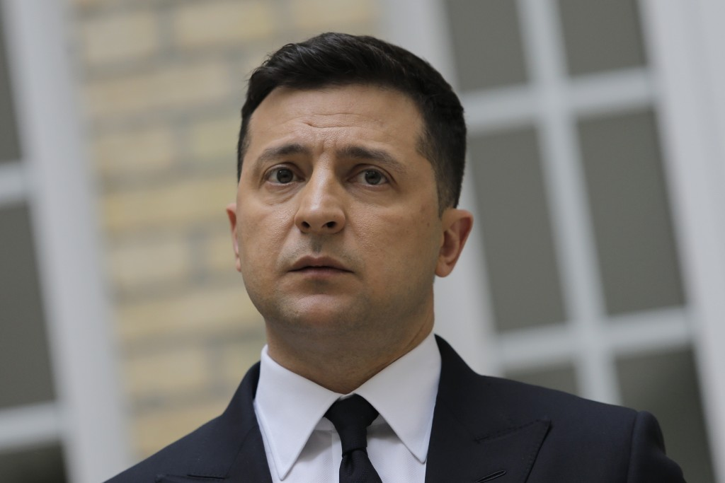 Ukrainian President Volodymyr Zelenskyy looks on during a press conference at the Ukrainian Embassy to France, Friday, April 16, 2021, in Paris. Ukrai...