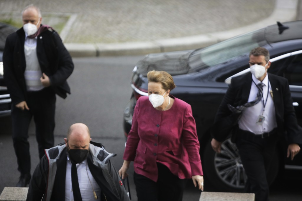 German Chancellor Angela Merkel arrives for a parliament session about a new law to battle the coronavirus pandemic at the parliament Bundestag in Ber...