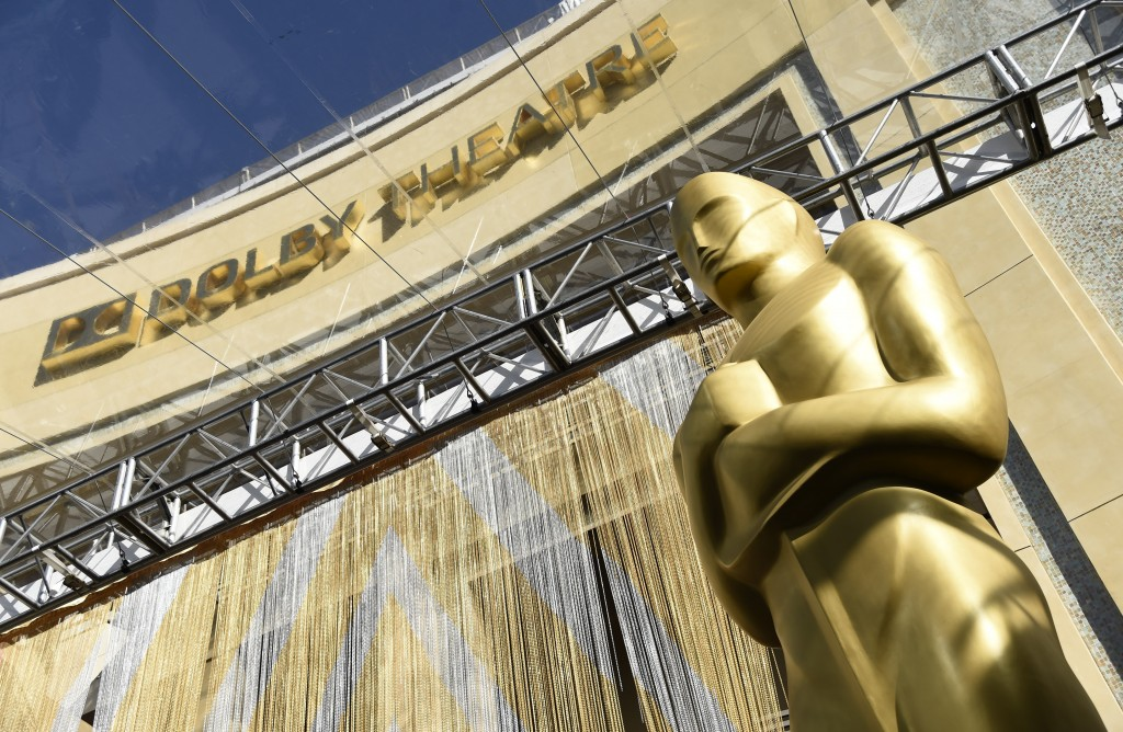 FILE - In this Feb. 24, 2016, file photo, an Oscar statue is pictured underneath the entrance to the Dolby Theatre in Los Angeles. When the Oscars bro...