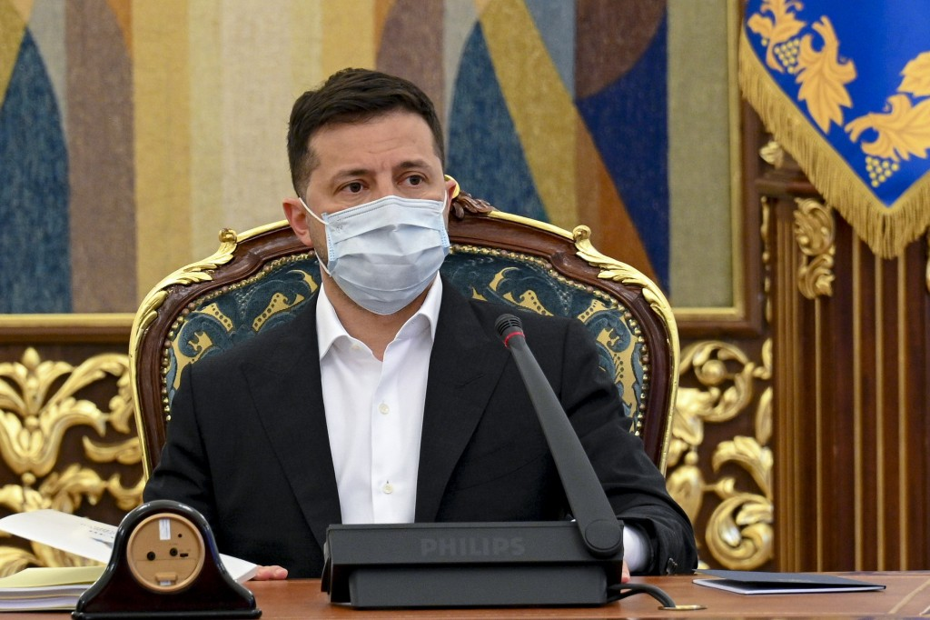 In this photo released by Ukrainian Presidential Press Office, Ukrainian President Volodymyr Zelenskyy leads a meeting of the National Security and De...