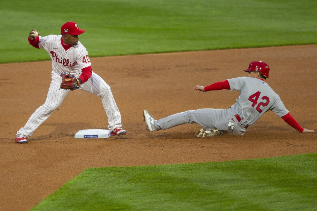 St Louis Cardinals Tommy Edmann is out at second as Philadelphia Phillies second baseman Jean Segura throws to first for a double play during the firs...