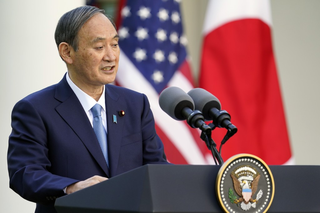 Japanese Prime Minister Yoshihide Suga, speaks at a news conference with President Joe Biden in the Rose Garden of the White House, Friday, April 16, ...