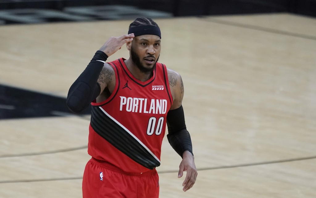 Portland Trail Blazers forward Carmelo Anthony (00) reacts after scoring against the San Antonio Spurs during the second half of an NBA basketball gam...
