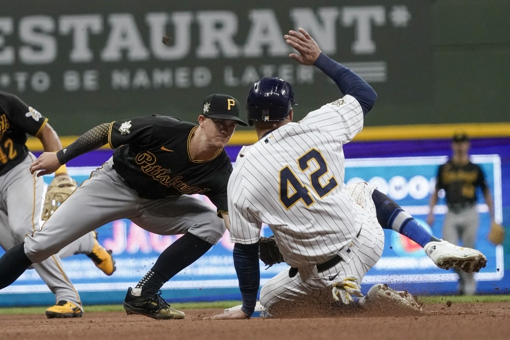 Pittsburgh Pirates' Kevin Newman tags out Milwaukee Brewers' Avisail Garcia as he tries to steal second during the sixth inning of a baseball game Fri...