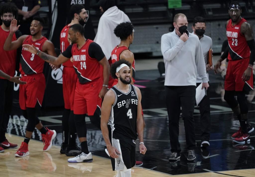 San Antonio Spurs guard Derrick White (4) walks off the court as the Portland Trail Blazers celebrate their win in an NBA basketball game in San Anton...