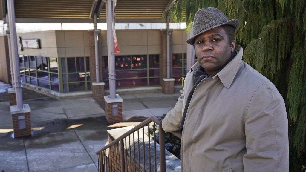 Andre Brady poses for a photo outside the former public university bookstore, Thursday, Jan. 21, 2021, in Youngstown, Ohio. On its surface, the story ...
