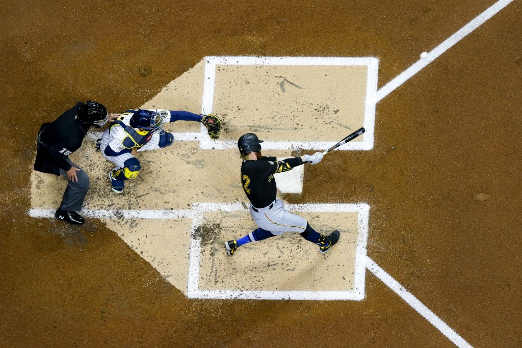 Pittsburgh Pirates' Colin Moran hits a home run during the second inning of a baseball game against the Milwaukee Brewers Friday, April 16, 2021, in M...