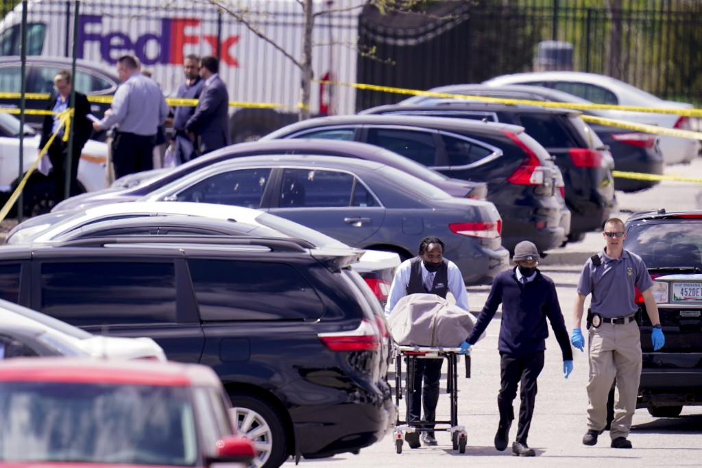 A body is taken from the scene where multiple people were shot at a FedEx Ground facility in Indianapolis, Friday, April 16, 2021. A gunman killed sev...