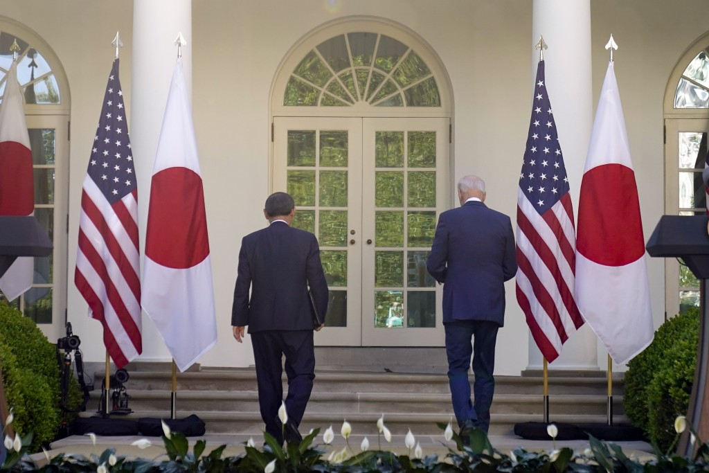 President Joe Biden and Japanese Prime Minister Yoshihide Suga leave after a news conference in the Rose Garden of the White House, Friday, April 16, ...