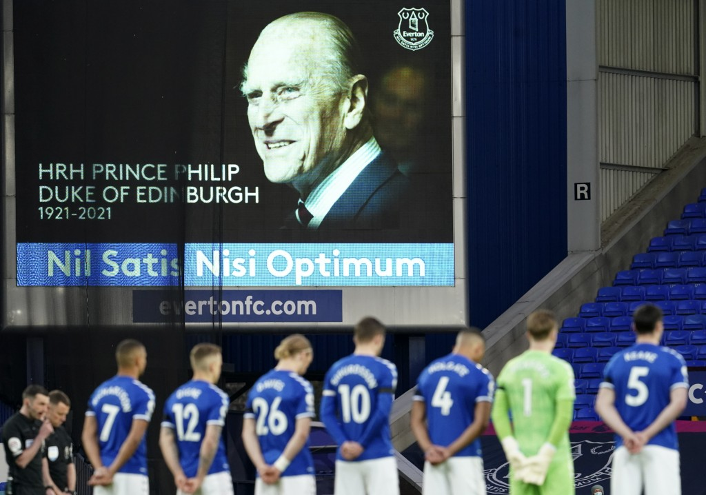 Everton players observe a two minute's silence in memory of the Prince Philip, following the announcement of his death at the age of 99, ahead of the ...