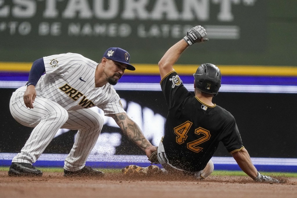 Milwaukee Brewers' Jace Peterson tags out Pittsburgh Pirates' Adam Frazier as he is caught stealing second during the third inning of a baseball game ...