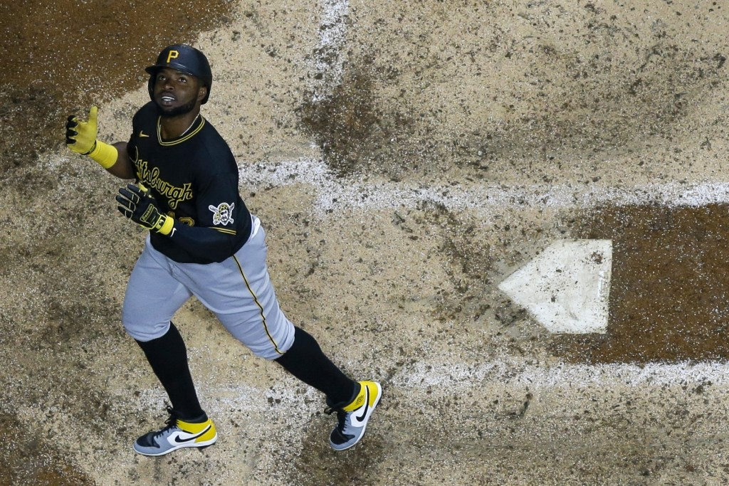 Pittsburgh Pirates' Gregory Polanco looks up as he crosses home after hitting a two-run home run during the eighth inning of a baseball game against t...