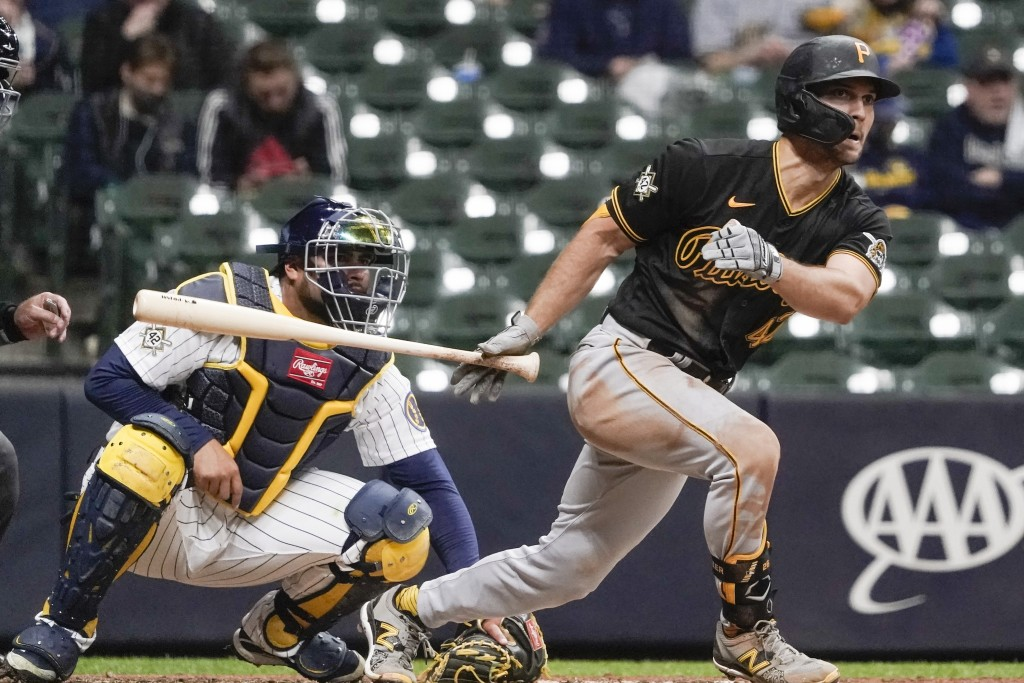 Pittsburgh Pirates' Adam Frazier hits a two-run scoring triple during the fifth inning of a baseball game against the Milwaukee Brewers Friday, April ...