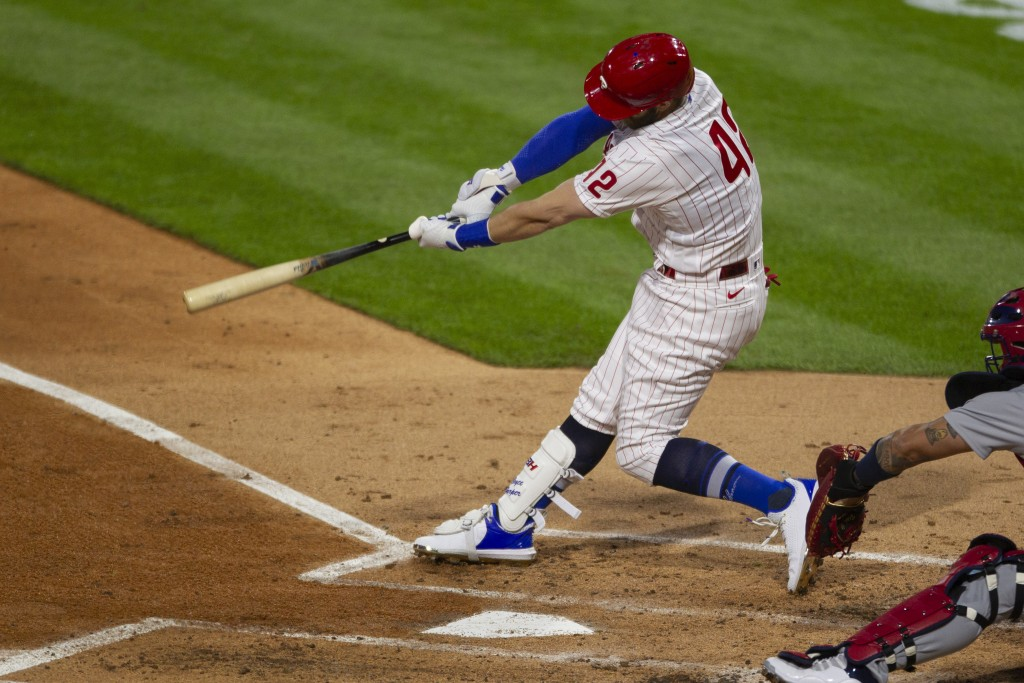 Philadelphia Phillies Bryce Harper swings on an RBI double during the second inning of the team's baseball game against the St. Louis on Cardinals, Fr...