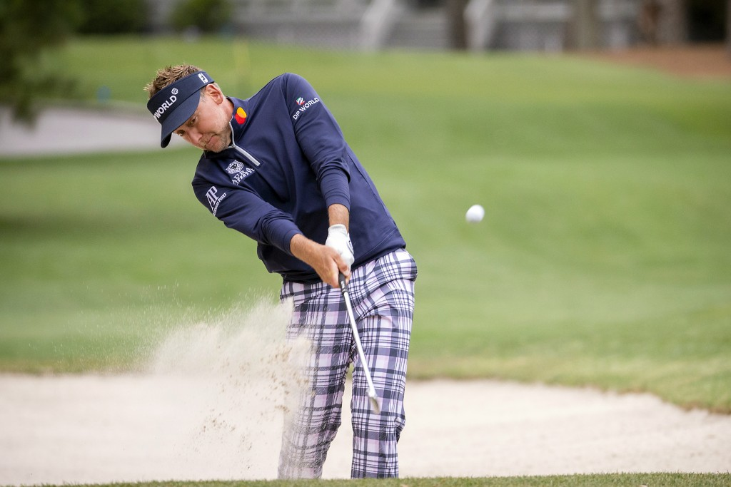 Ian Poulter, of England, hits out of the bunker on the 15th fairway during the second round of the RBC Heritage golf tournament in Hilton Head Island,...