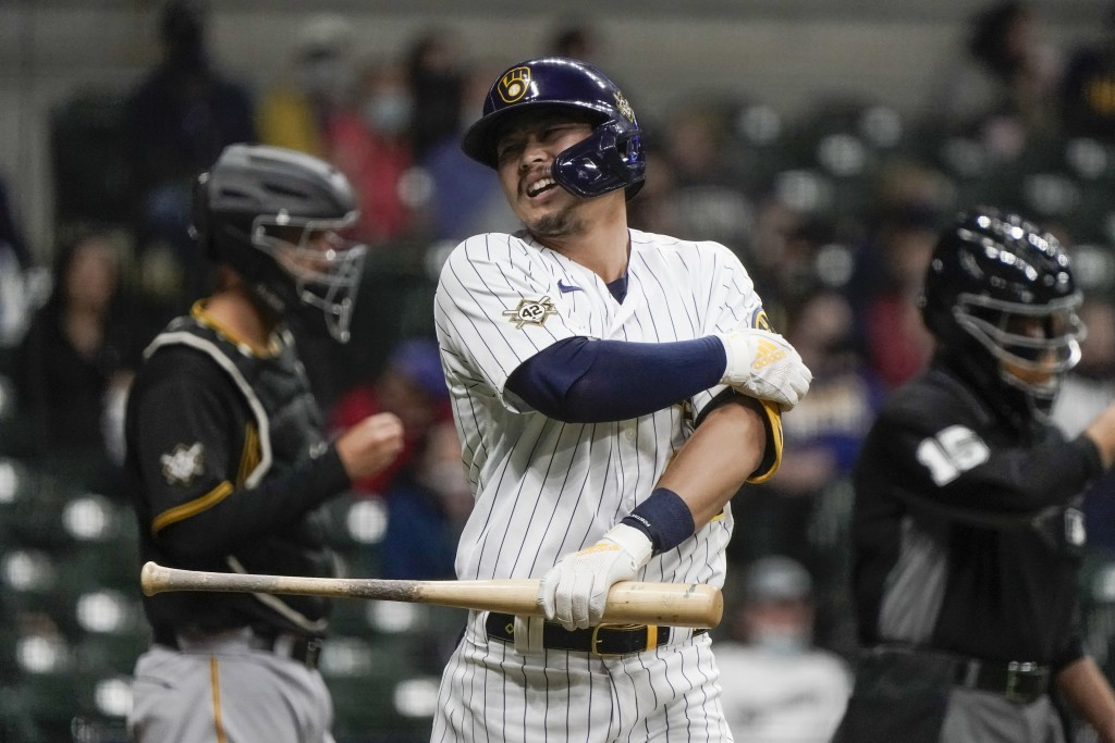Milwaukee Brewers' Keston Hiura reacts after being hit by a pitch during the third inning of a baseball game against the Pittsburgh Pirates Friday, Ap...