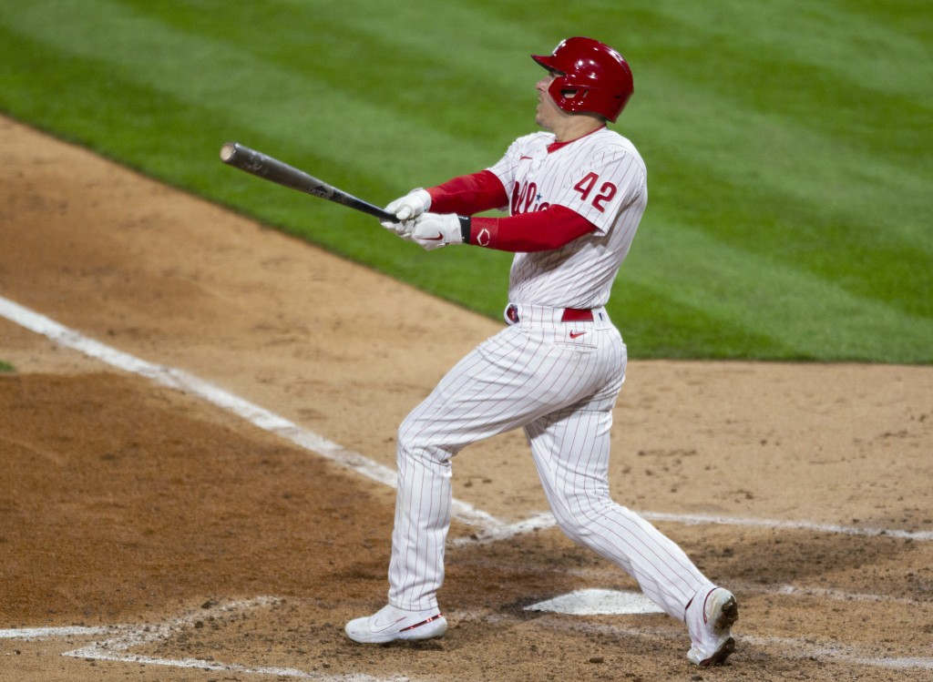 Philadelphia Phillies' JT Realmuto watches his two-run home run during the seventh inning of the team's baseball game against the St. Louis Cardinals,...