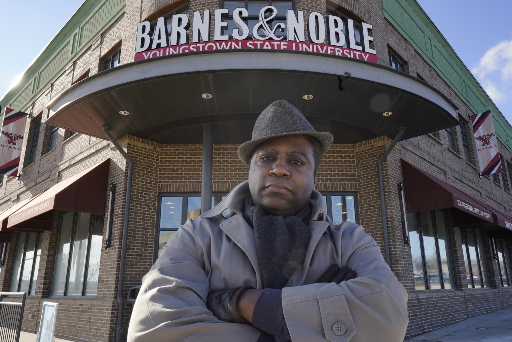 Andre Brady poses for a photo outside the Barnes & Noble, Thursday, Jan. 21, 2021, in Youngstown, Ohio. On its surface, the story of Brady's fight to ...