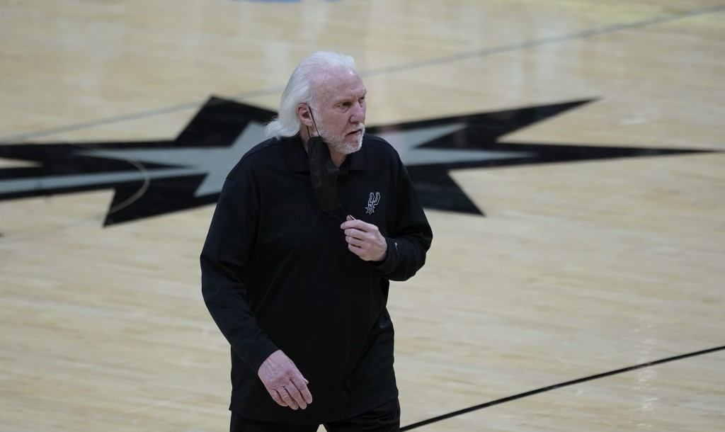 San Antonio Spurs head coach Gregg Popovich walks off the court after the team's loss against the Portland Trail Blazers in an NBA basketball game in ...