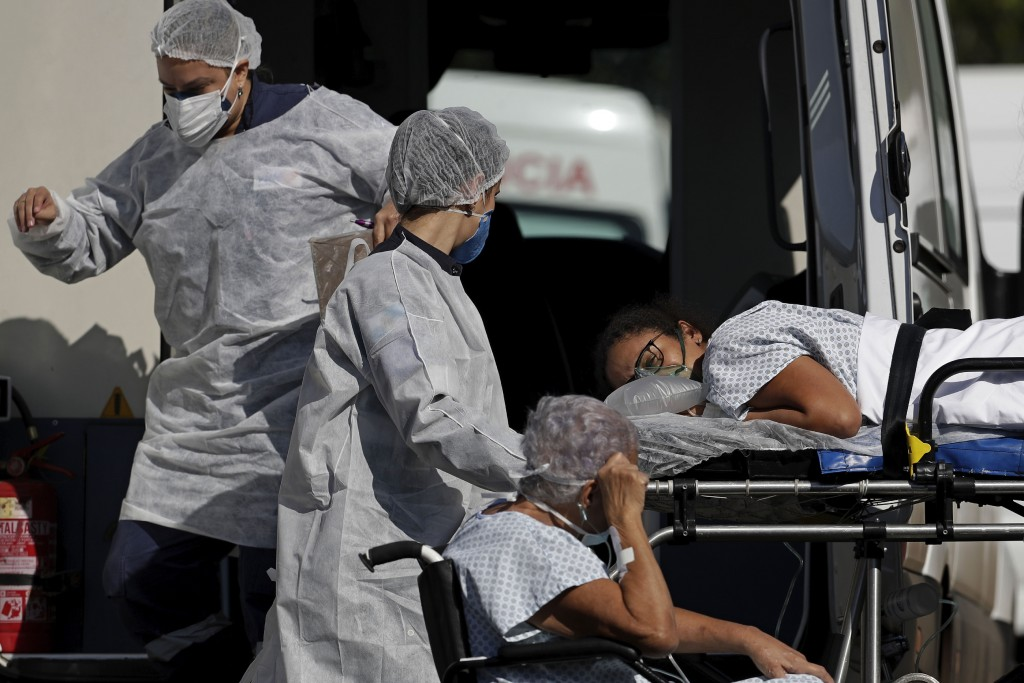Healthcare workers transfer patients from ambulances to the HRAN public hospital in Brasilia, Brazil, Friday, April 16, 2021. Lack of required medicin...