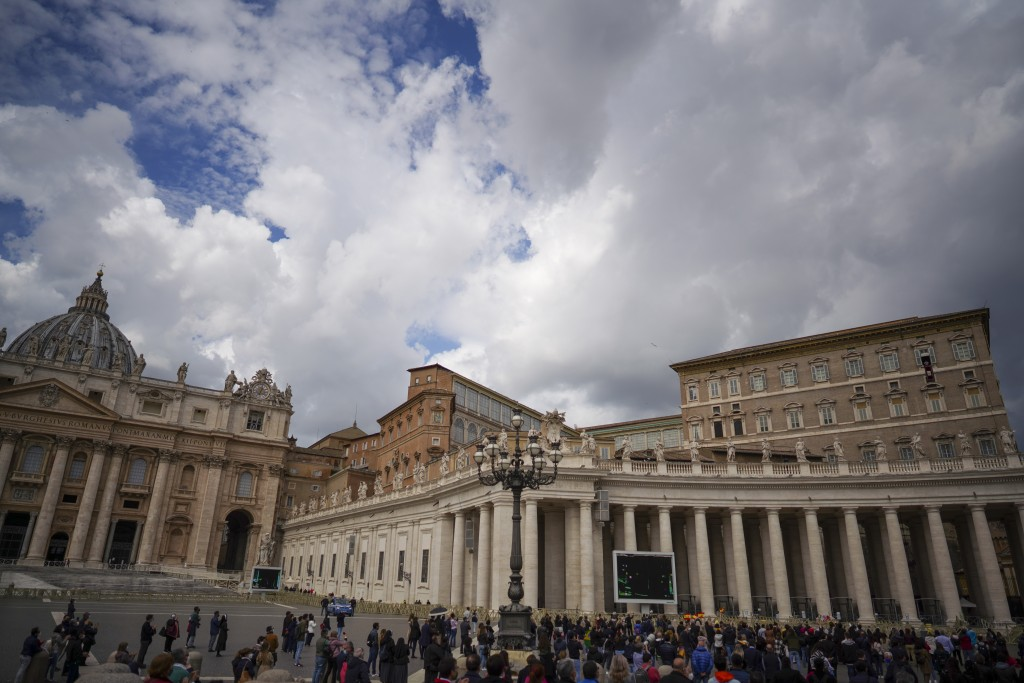 Pope Francis delivers his blessing as he recites the Regina Caeli noon prayer from the window of his studio overlooking St.Peter's Square, at the Vati...